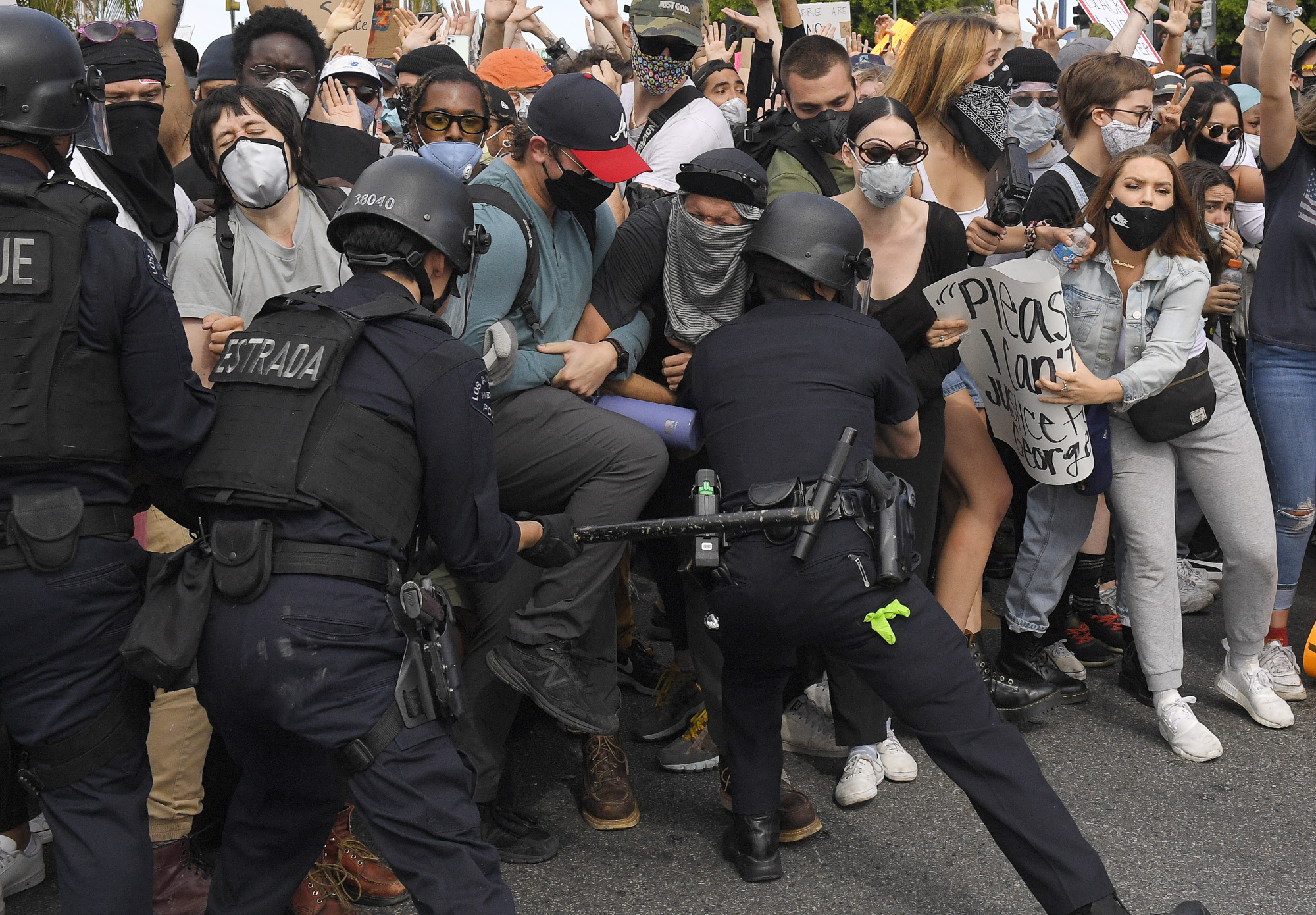 Los Angeles police officers strike demonstrators as they try to push them back during a protest over the death of George Floyd, May 30, 2020, in Los Angeles. Photo by Mark J. Terrill, AP Photo