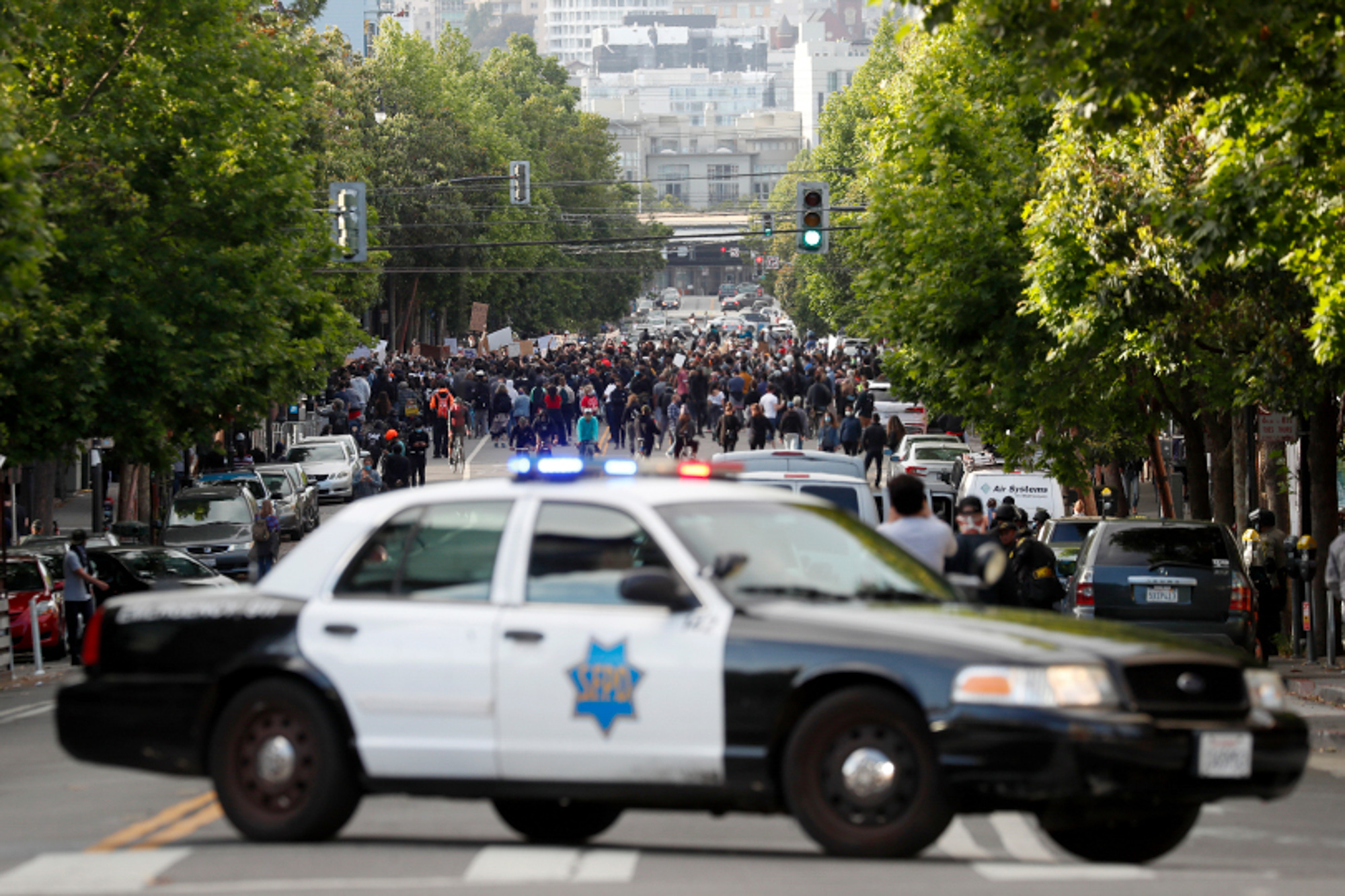A patrol car closes off Valencia Street in San Francisco after a group of protesters gathered in front of the Mission Police Station on May 30, 2020, the second day of Bay Area unrest over the George Floyd killing in Minneapolis. Photo by Karl Mondon, Bay Area News Group
