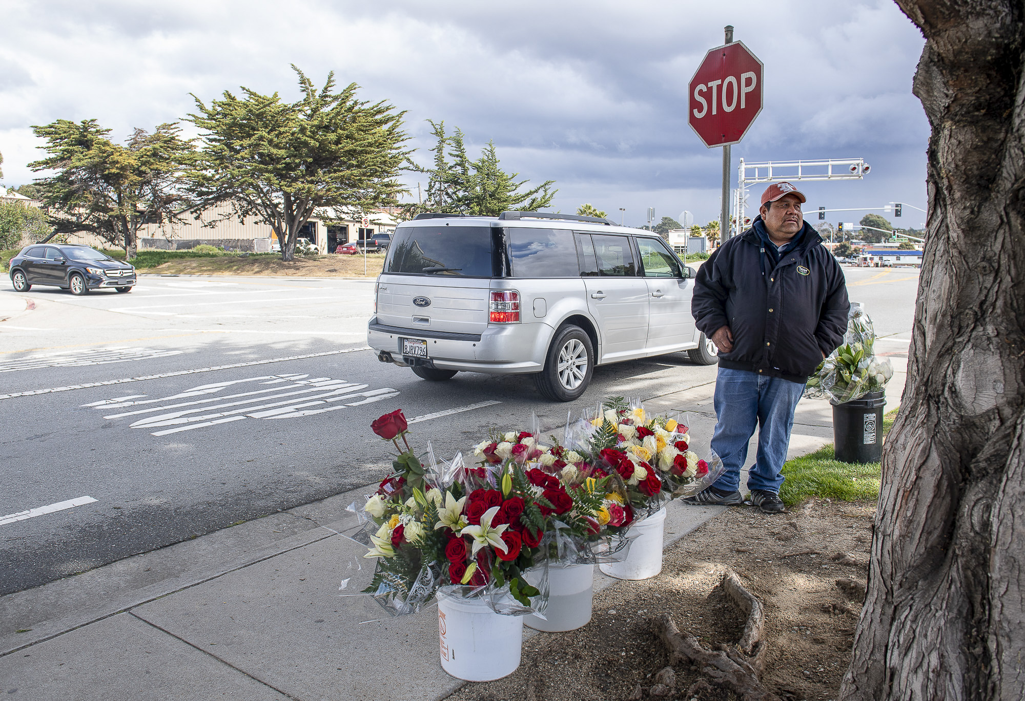 Isidoro Contreras Flores, sells an arrangnment of flowers in Seaside, Calif, on Tuesday, March 17, 2020. Photo by David Rodriguez, The Salinas Californian