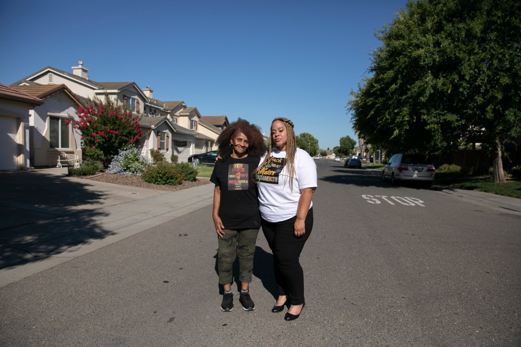 Cierra Washington-Griffin, right, and her grandmother, Barbara Washington near her grandmother's home in Elk Grove on June 22, 2020. Washington-Griffin regularly goes back and forth between the Sacramento area and North Carolina. Photo by Anne Wernikoff for CalMatters