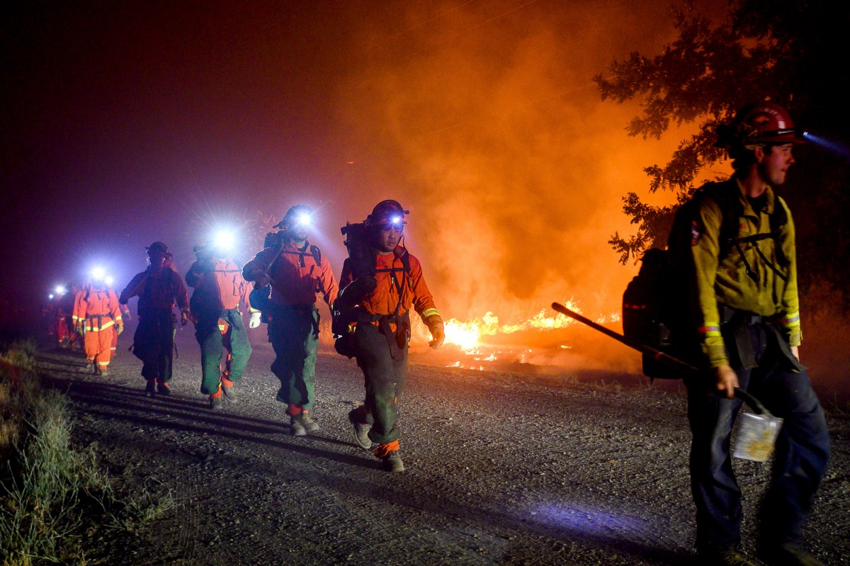 Inmate firefighters, left, battle the Quail Fire burning near Winters, Calif., on Sunday, June 7, 2020. Photo by Noah Berger, AP Photo