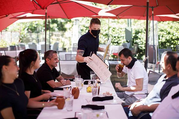 Cleverson Davis, a waiter at Palermo Italian Restaurant in San Jose, Calif., tends to customers while wearing a mask on June 5, 2020. Photo by Dai Sugano, Bay Area News Group