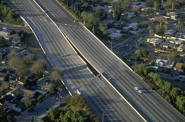 Many roads, including bridges and elevated highways were damaged by the 6.7 magnitude Northridge Earthquake on January 17, 1994. Approximately 114,000 residential and commercial structures were damaged and 72 deaths were attributed to the earthquake. Photo by Robert A. Eplett, FEMA News Photo via Wikimedia Commons