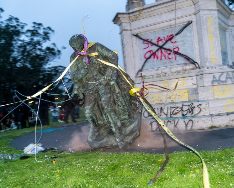 The statue of Francis Scott Key hits the ground after a group of more than one hundred protestors used ropes to pull it down in Golden Gate Park in San Francisco on June 19, 2020. Photo by Jungho Kim